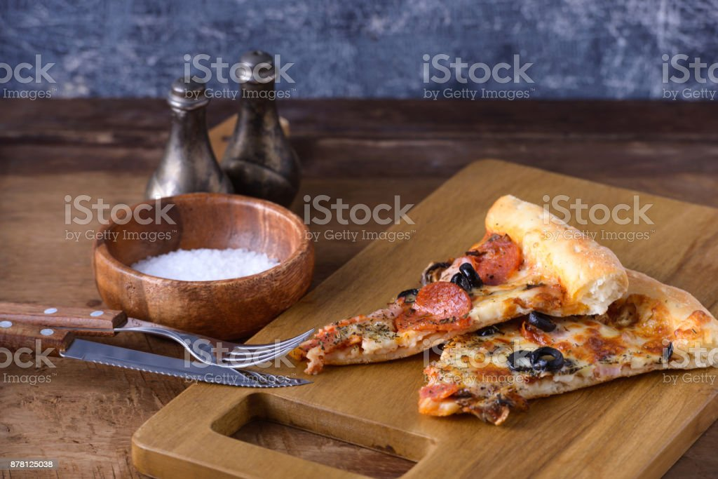 Homemade pizza on wooden board stock photo