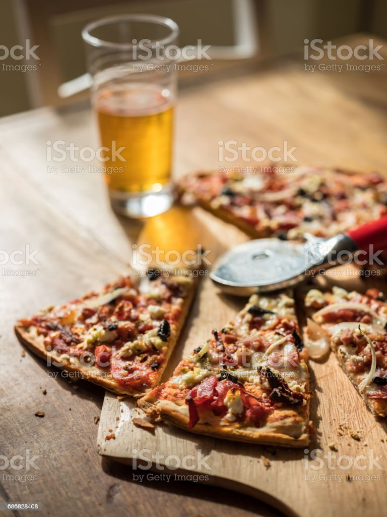 Homemade Pizza on wooden table with Beer - foto stock