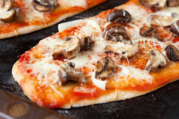 homemade pizza with mushrooms and mozzarella stock photo
