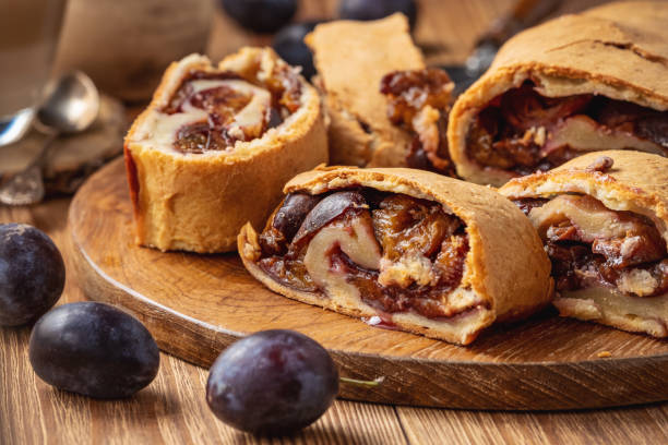 Homemade plum roll cake, strudel with plum filling. stock photo