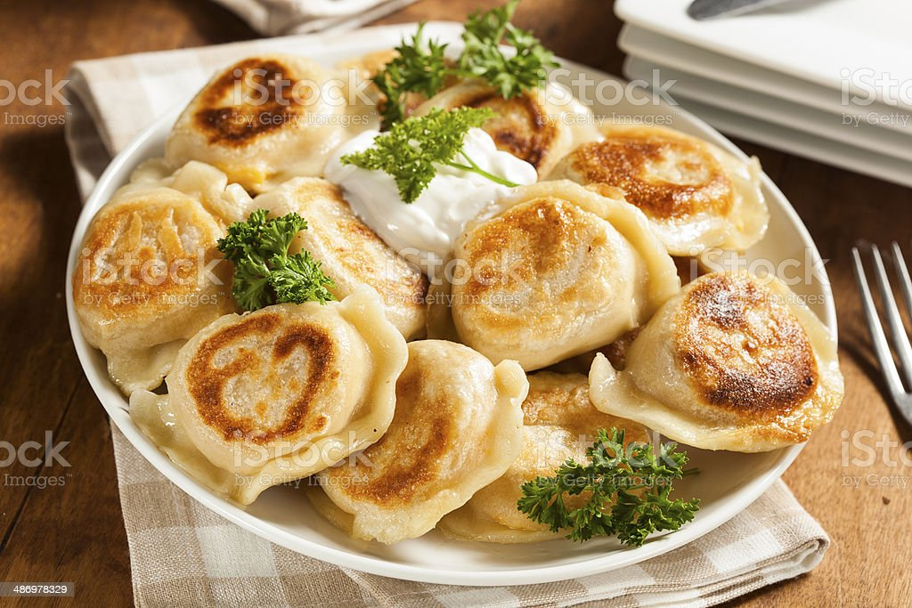 Homemade Polish Pierogis with Sour Cream stock photo