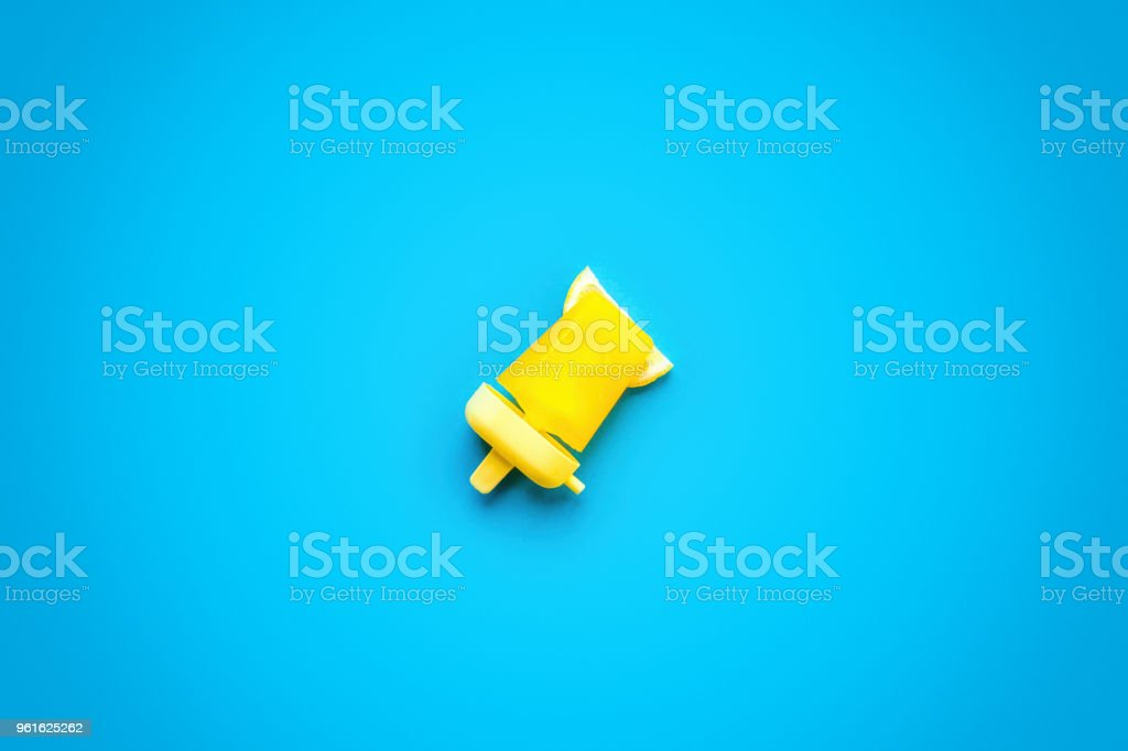 Homemade Popsicles isolated on blue stock photo