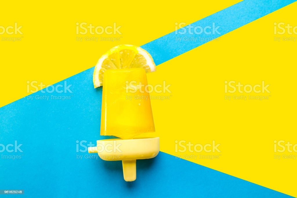 Homemade Popsicles isolated on blue yellow stock photo