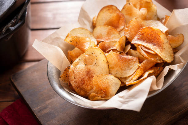 Homemade Potato Chips Fresh Homemade Potato Chips homemade stock pictures, royalty-free photos & images