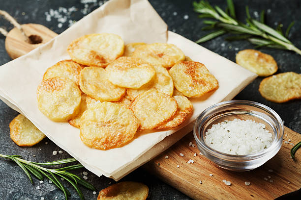 Homemade potato chips with sea salt and herbs stock photo