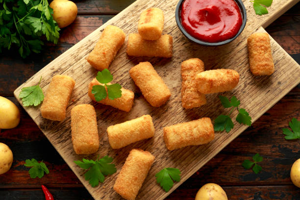 Homemade Potato Croquettes with dipping sauce on wooden board stock photo