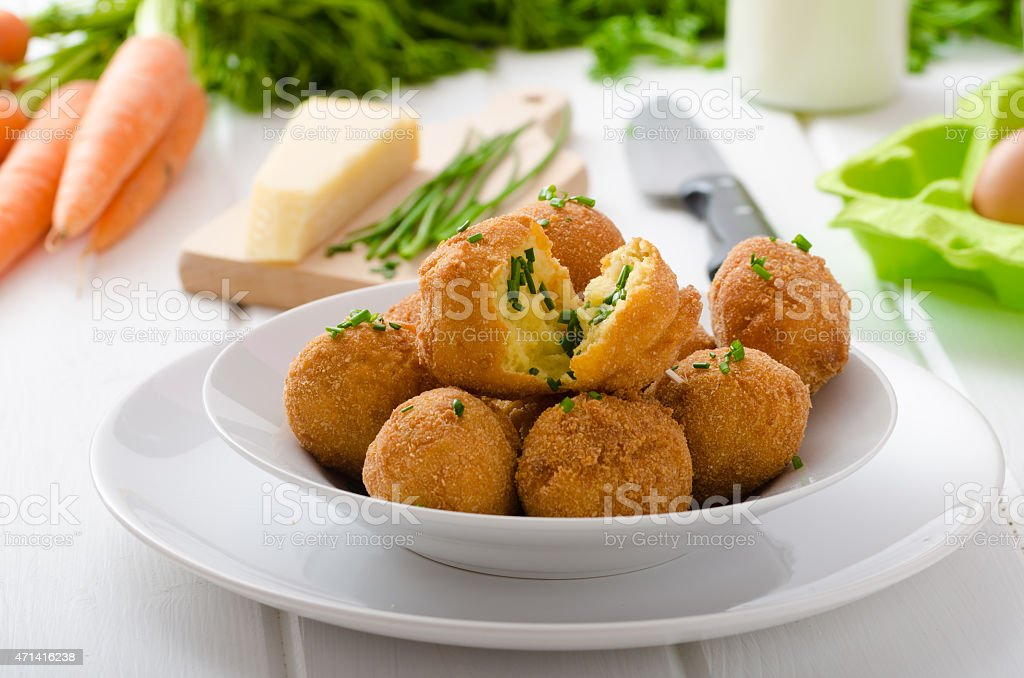 Homemade potato croquettes with parmesan and chives stock photo