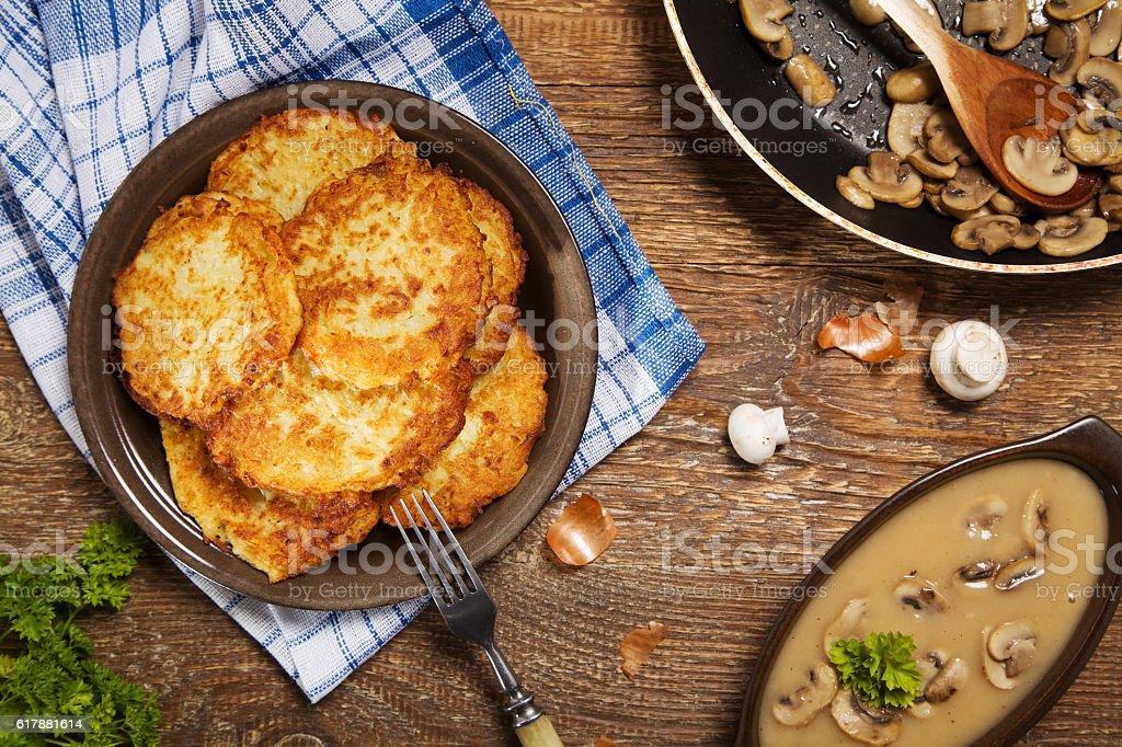 Homemade potato pancakes served with mushroom sauce and mushroom stock photo
