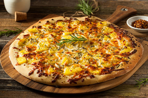 homemade potato rosemary pizza - kartoffelpizza stock-fotos und bilder