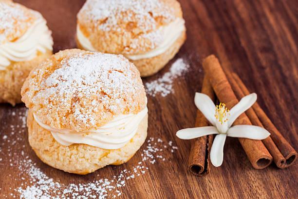Homemade profiteroles with cream, selective focus