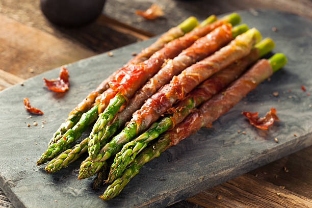 Homemade Prosciutto Wrapped Asparagus stock photo