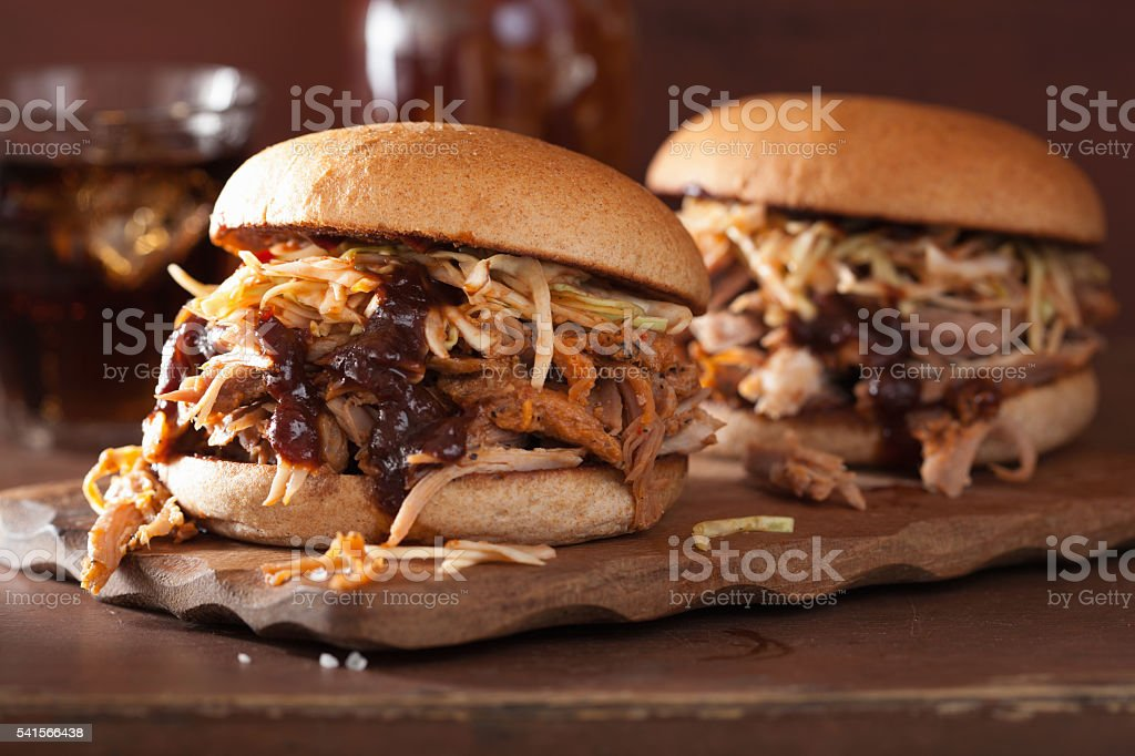 homemade pulled pork burger with coleslaw and bbq sauce stock photo