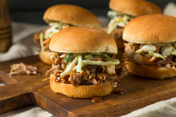 homemade pulled pork sliders - sliding stock photos and pictures