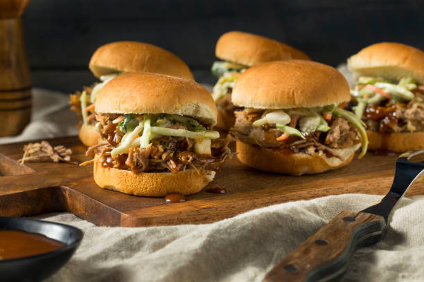 Homemade Pulled Pork Sliders Homemade Pulled Pork Sliders with Barbecue Sauce main course stock pictures, royalty-free photos & images