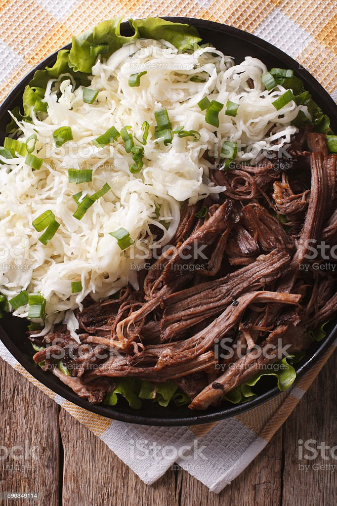 Homemade Pulled pork with sauerkraut closeup. vertical top view royalty-free stock photo
