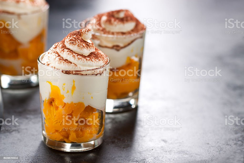 Homemade pumpkin dessert made from pumpkin puree and heavy cream stock photo