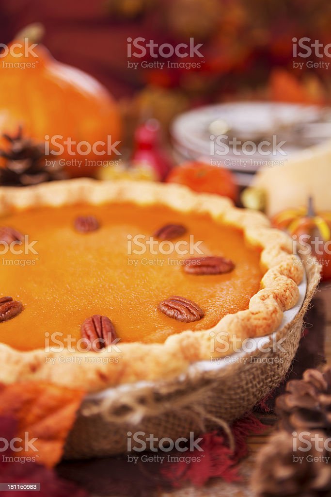 Homemade pumpkin pie on a rustic table royalty-free stock photo