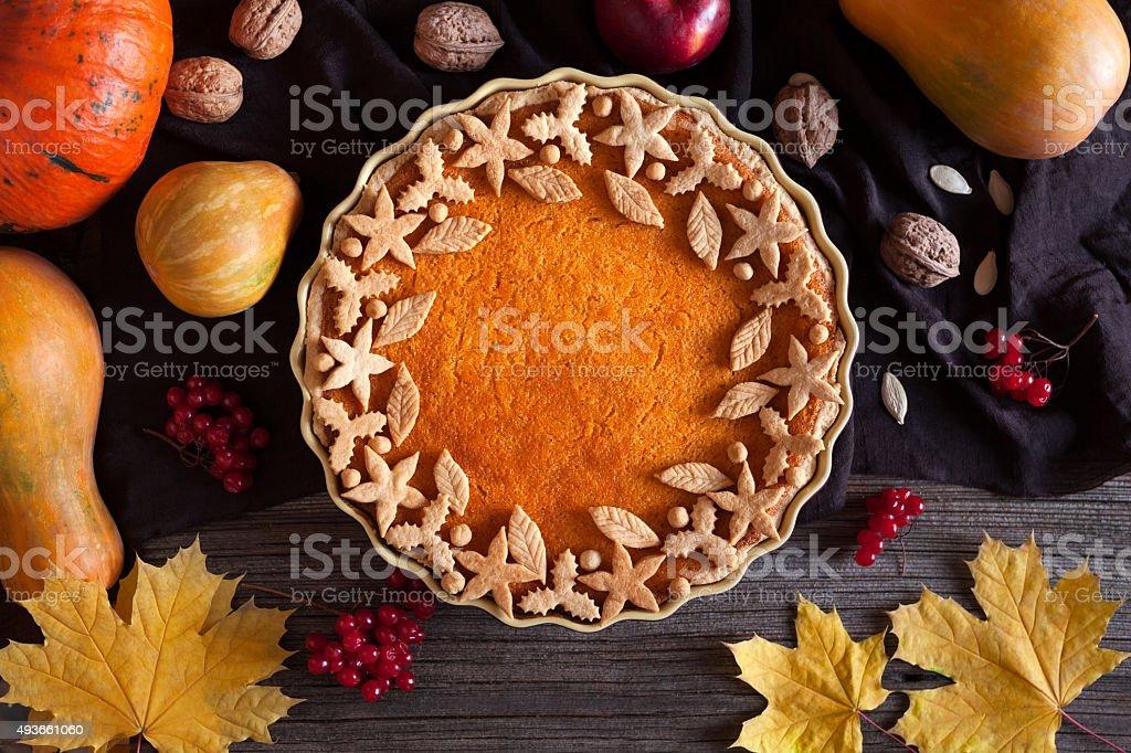 Homemade pumpkin tart pie organic sweet dessert food with various stock photo