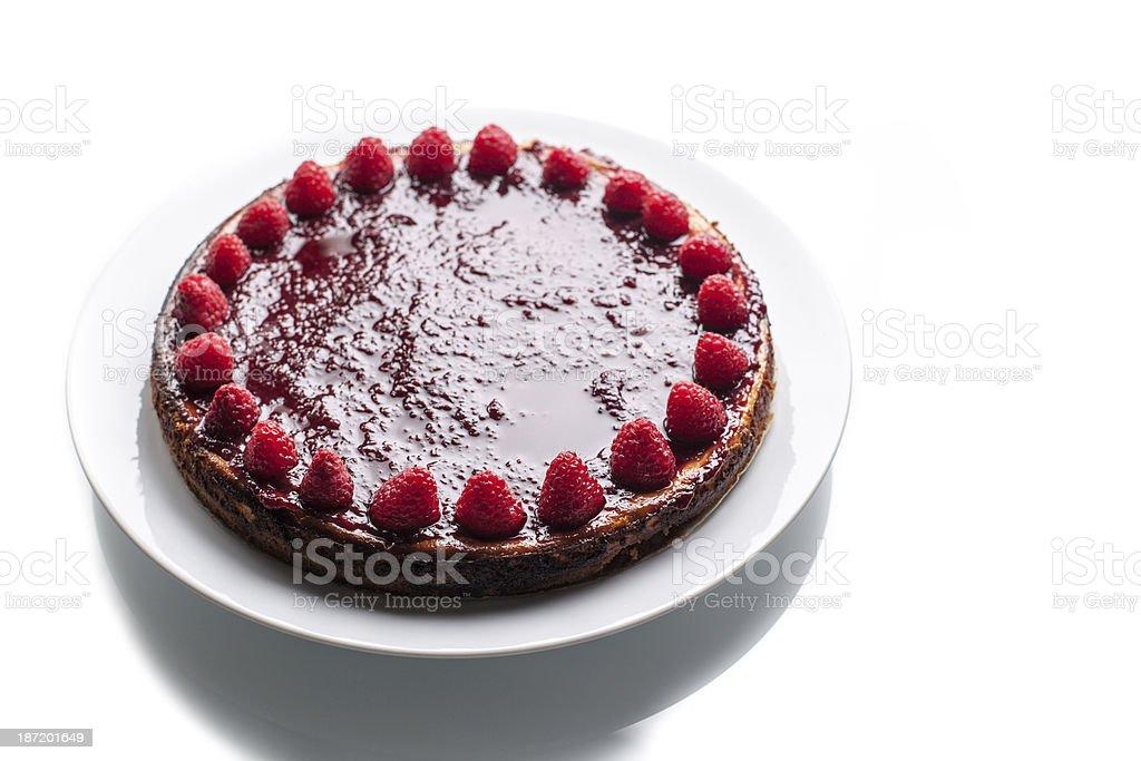 Homemade Raspberry Cheesecake On White Table stock photo