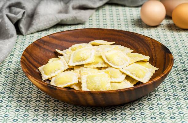 Homemade ravioli on rustic background - foto stock