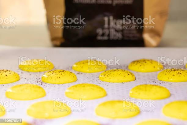 Homemade Raw Macaroons And Packet Of Chocolate In The Background Stock Photo - Download Image Now