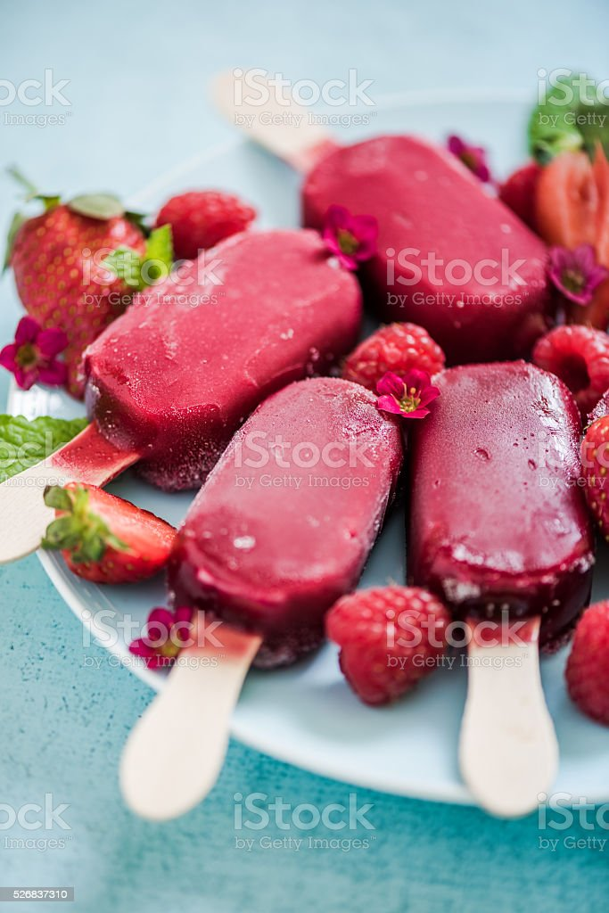 homemade refreshing berry popsicle stock photo