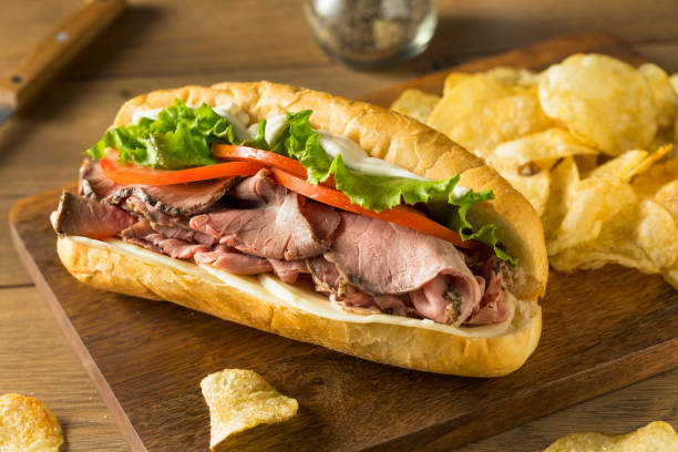 Homemade Roast Beef Deli Sandwich Homemade Roast Beef Deli Sandwich with Lettuce and Tomato roast beef stock pictures, royalty-free photos & images
