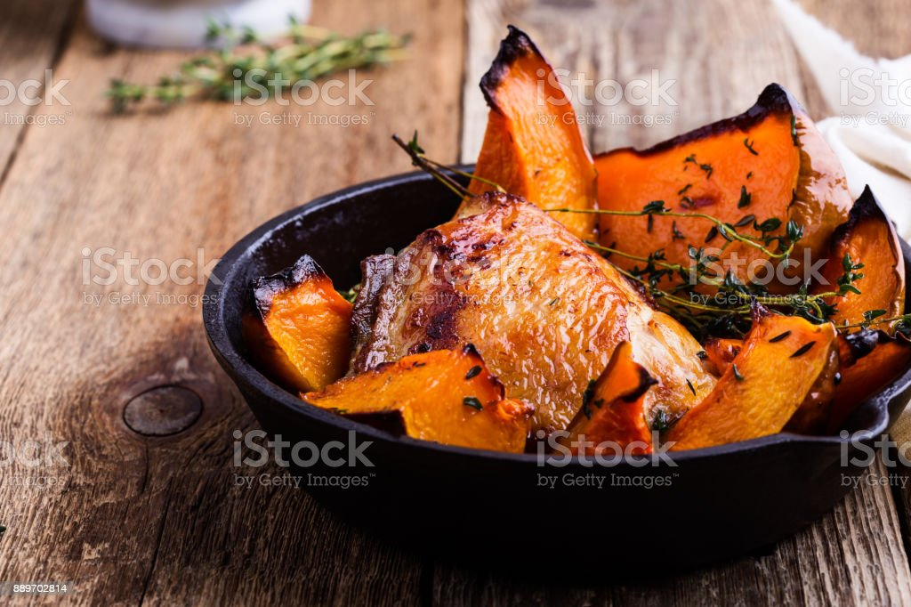 Homemade roast chicken thighs with butternut squash stock photo