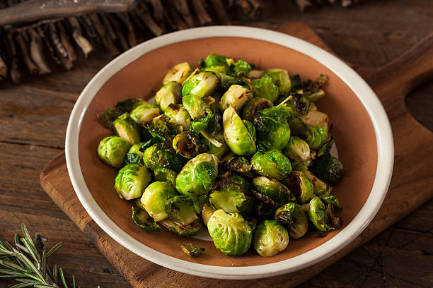 homemade roasted brussel sprouts - brussels sprout stock photos and pictures