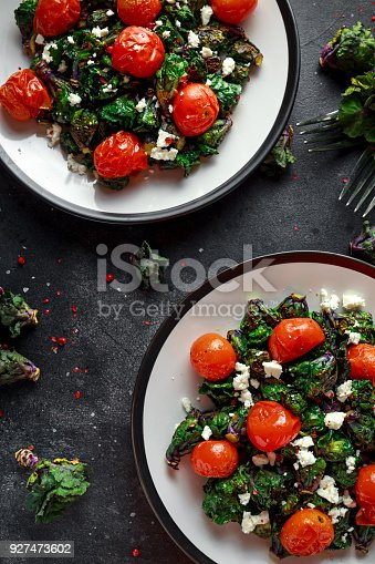istock Homemade Roasted Green Kalettes salad with cherry tomatoes and feta cheese. healthy food 927473602