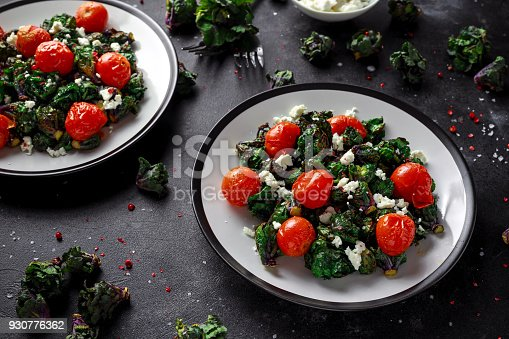 istock Homemade Roasted Green Kalettes salad with cherry tomatoes and feta cheese. healthy food 930776362