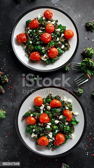 istock Homemade Roasted Green Kalettes salad with cherry tomatoes and feta cheese. healthy food 950347548