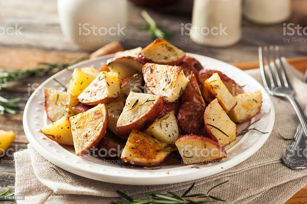 Homemade Roasted Herb Red Potatoes stock photo