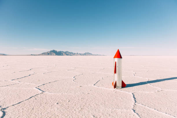 Homemade Rocket on Utah Salt Flats A generic homemade rocket sits on the Bonneville Salt Flats located in Utah, USA. No people are in the picture. The sky is blue and there is lots of copy space. bonneville salt flats stock pictures, royalty-free photos & images