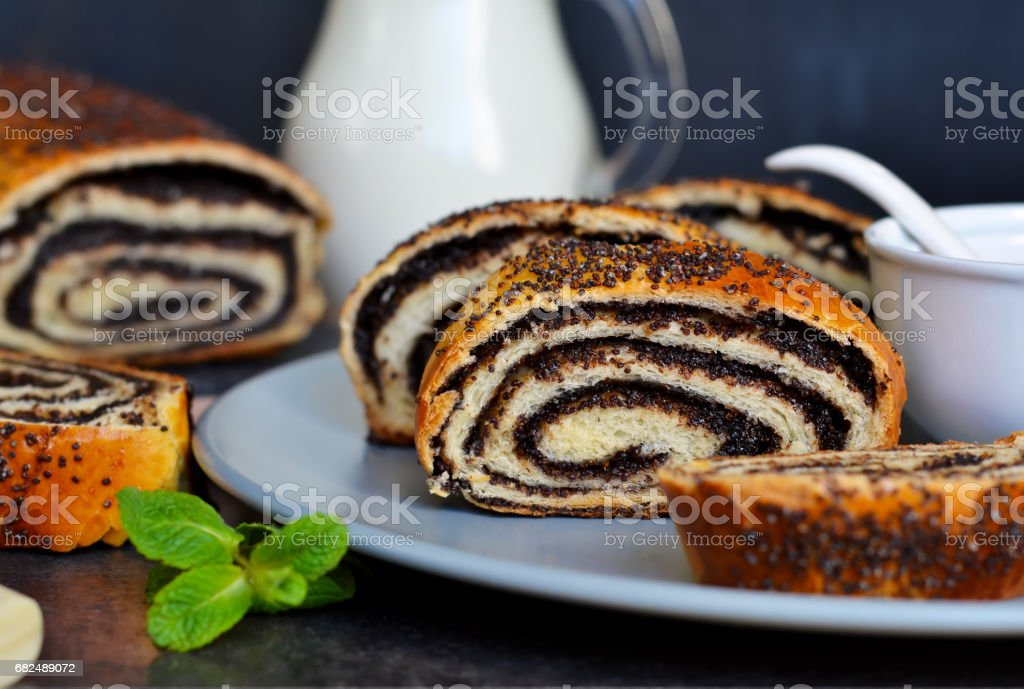 Homemade roll with poppy seeds and milk for breakfast royalty-free stock photo