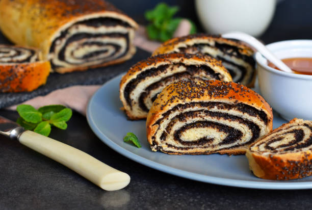 Homemade roll with poppy seeds and milk for breakfast stock photo