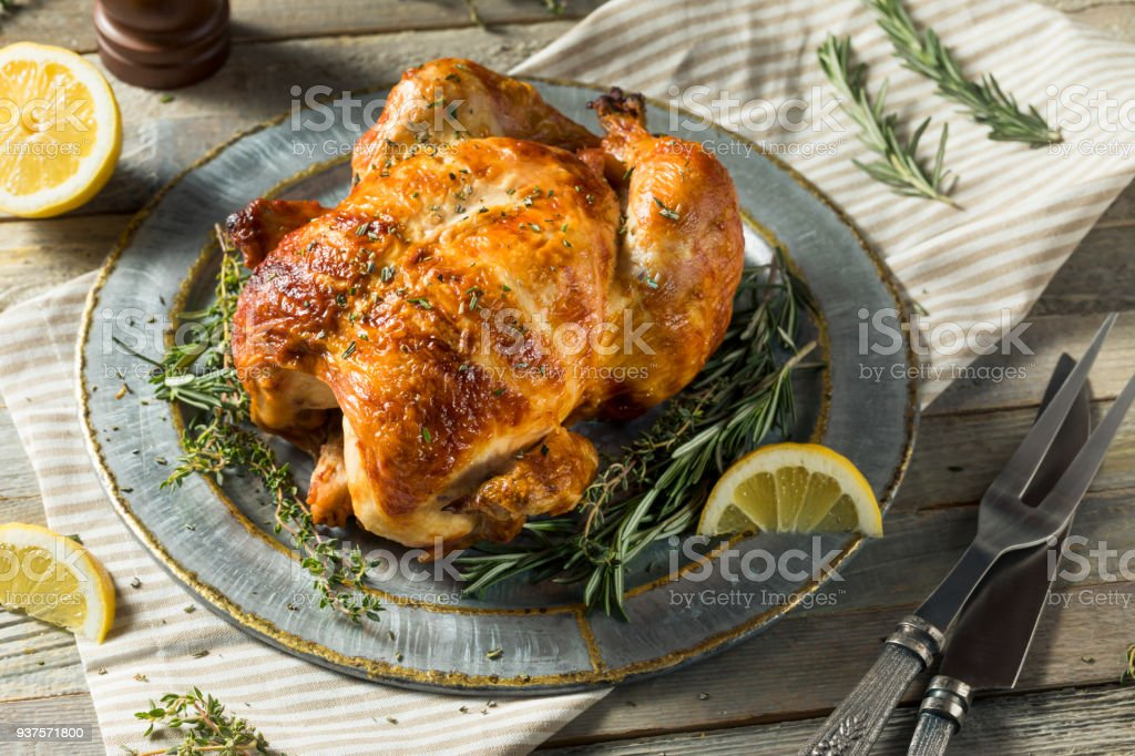 Homemade Rotisserie Chicken with Herbs stock photo