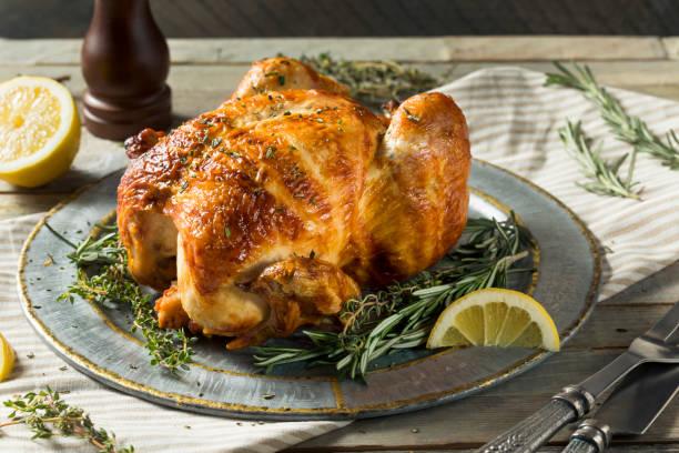 homemade rotisserie chicken with herbs - girarrosto foto e immagini stock