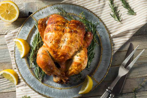 Homemade Rotisserie Chicken with Herbs Homemade Rotisserie Chicken with Herbs and Lemons chicken stock pictures, royalty-free photos & images