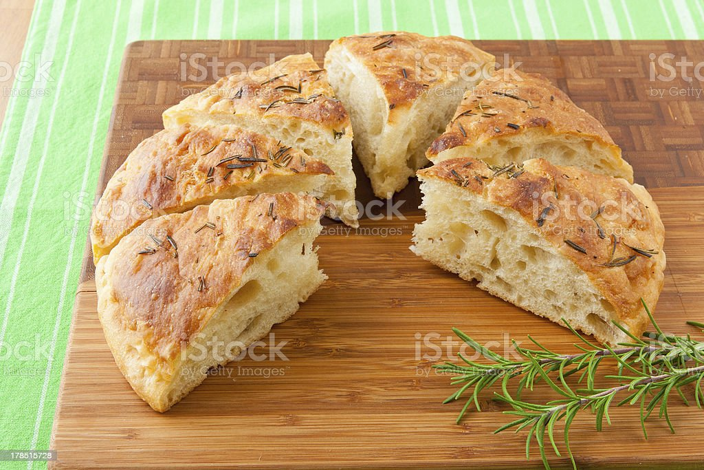 Homemade round Italian rosemary Focaccia bread sliced. royalty-free stock photo