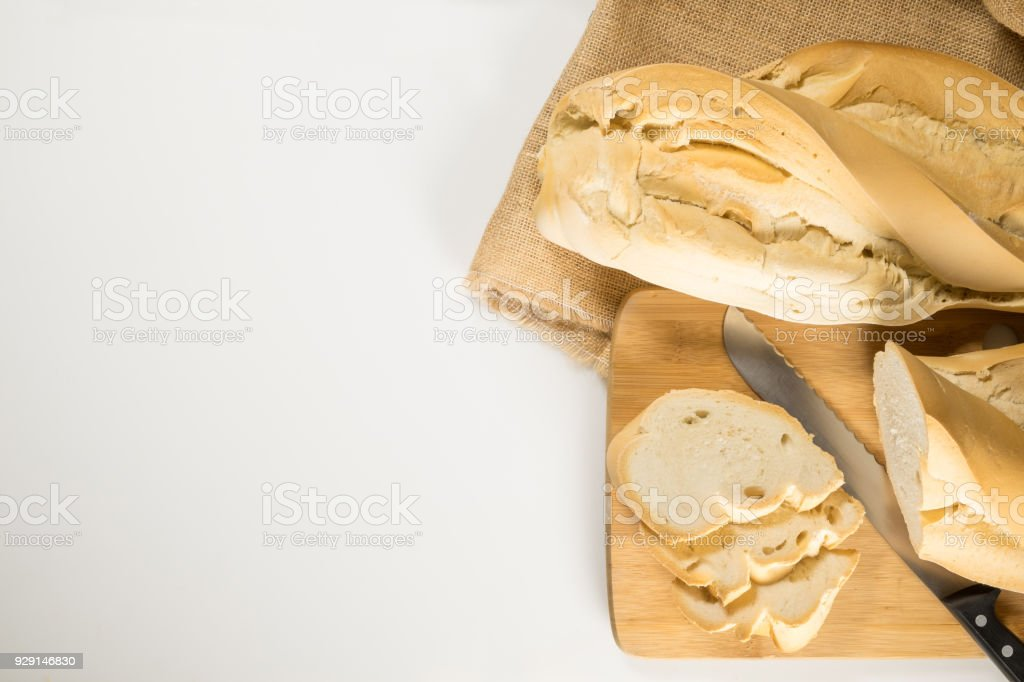 Homemade rustic bread, made of sourdough in a wood-fired oven on a white background so you can place your logo stock photo