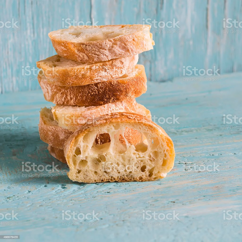 homemade rustic bread on a light wooden background stock photo
