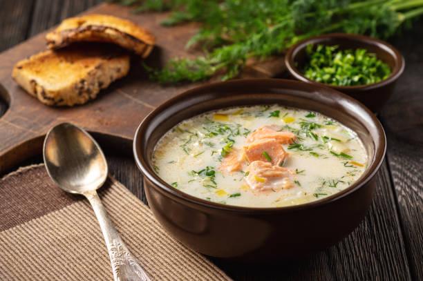 Homemade salmon and leek creamy soup. stock photo