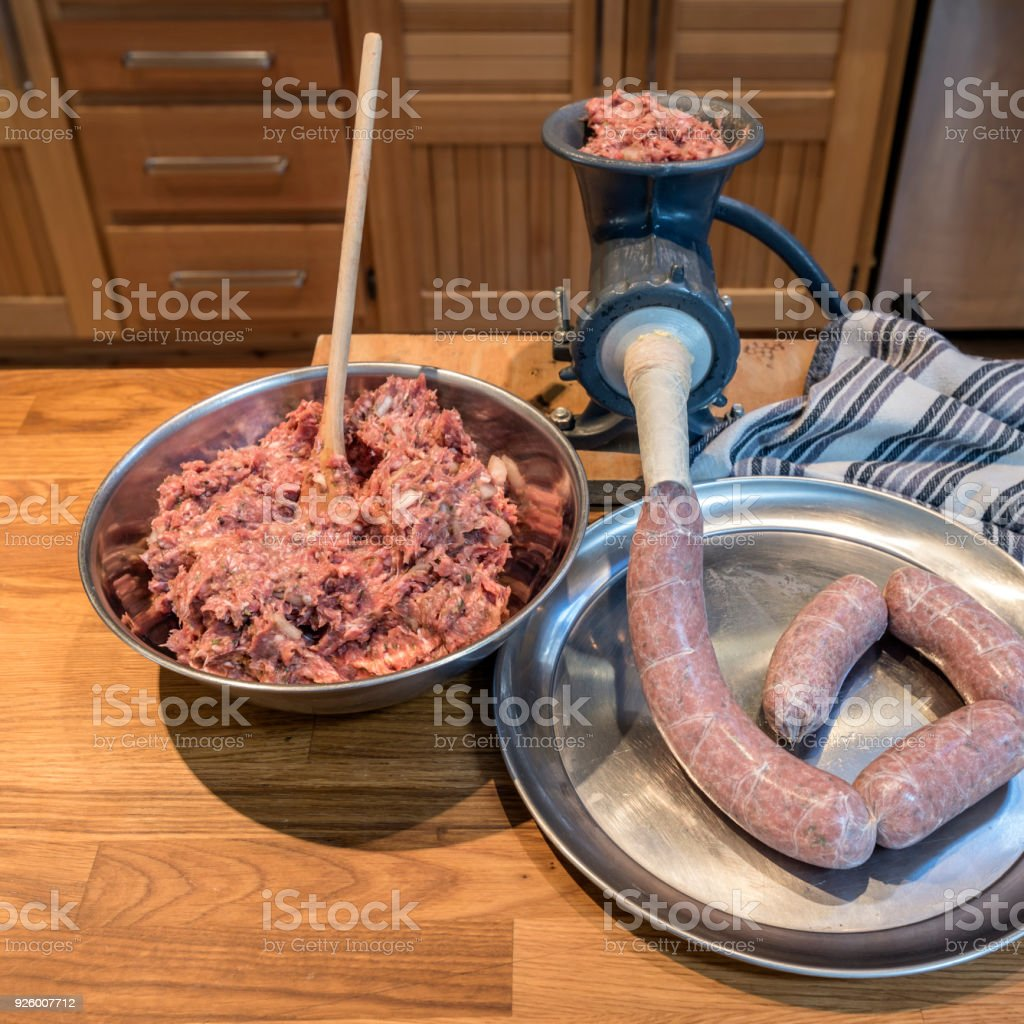 Homemade Sausage Being Stuffed into Casings stock photo