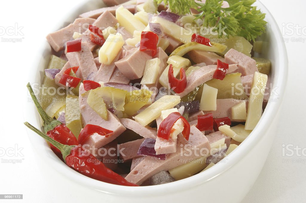 homemade sausage salad with cheese, gherkin and hot paprika royalty-free stock photo