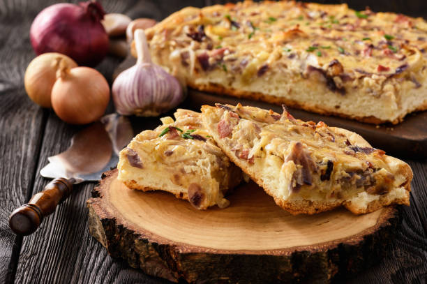 Homemade savory pie with onion, cheese and bacon. stock photo