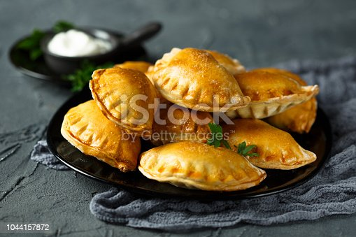 Homemade savory hand pies with potato, Feta cheese and garlic