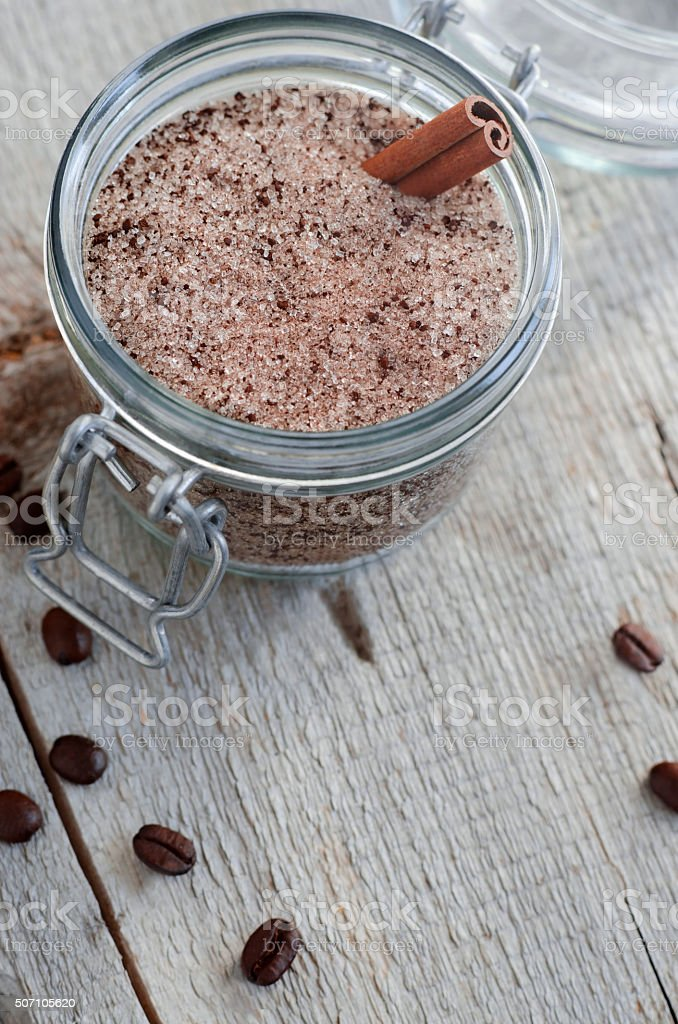 Homemade scrub made of sugar and ground coffee stock photo