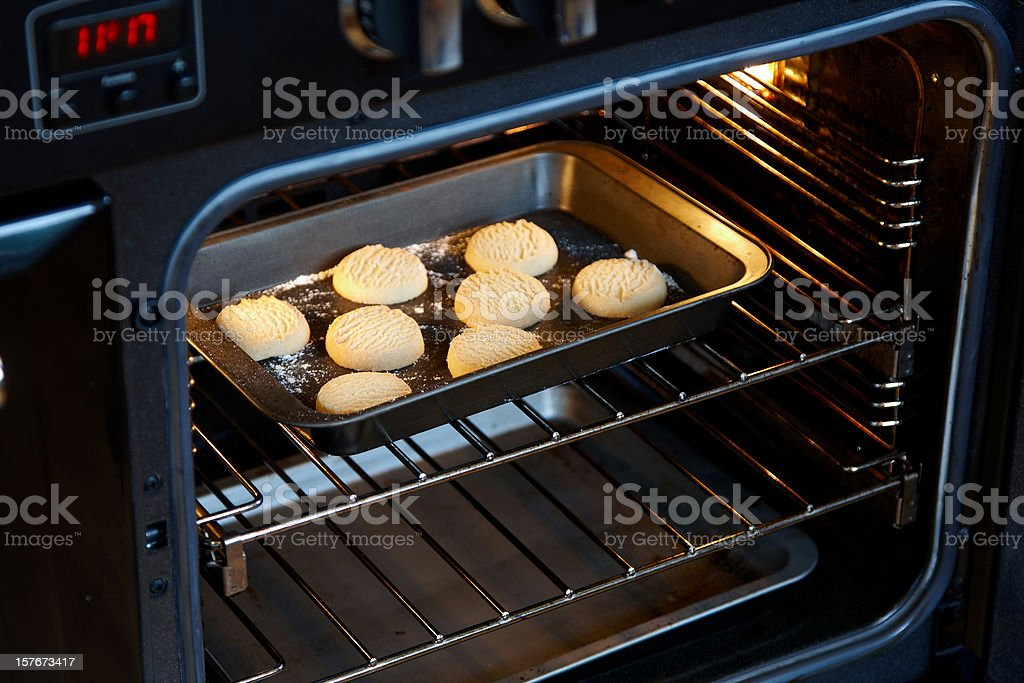 Homemade shortcrust biscuits coming out of oven royalty-free stock photo