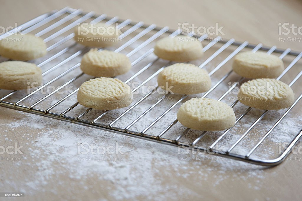 Homemade shortcrust biscuits on cooling tray stock photo